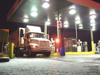 A US FoodService semi truck is fueled in a Champlain,NY truck stop.
